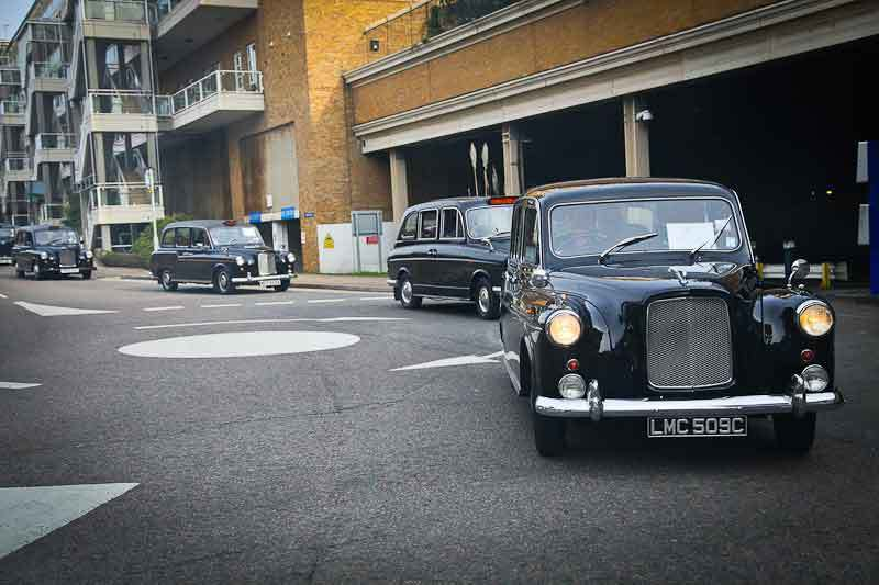 Cabalcade - a 1965 Austin FL2 leads out from Chelsea Harbour